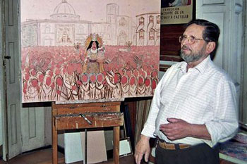Constante Gil with one of his paintings